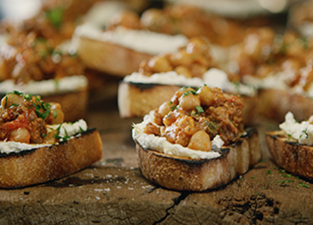 Crostini with Sausage Ragout and Ricotta Cheese